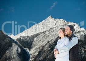 mountain travel, couple in the mountain with snow