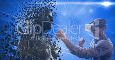 Man wearing virtual glasses while punching 3d human