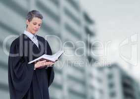 Judge holding book in front of buildings
