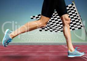 Runner legs on track against blue green background and checkered flag