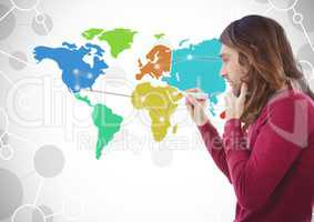 Man drawing on Colorful Map with connected background