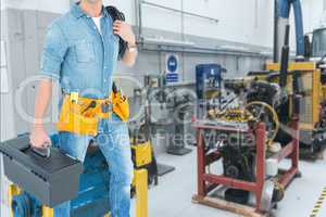 Midsection of worker working in workshop