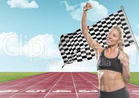 Female runner with hand in air on track against sky and checkered flag
