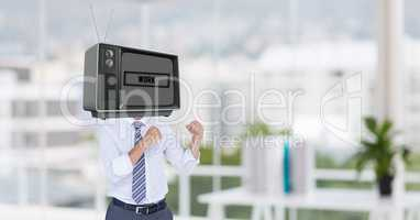 Businessman with TV on head standing in fighting posture