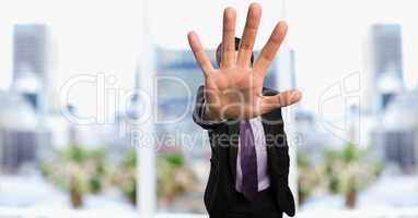 Businessman showing stop gesture in city