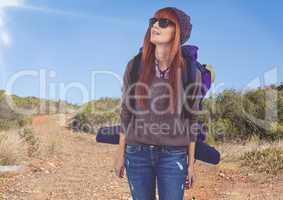 mountain travel,woman mountaineer with sun glasses in the road