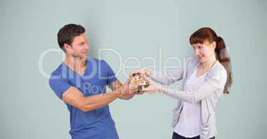 Man and woman fighting for house model
