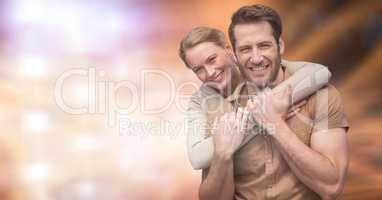 Portrait of happy couple over blurred background