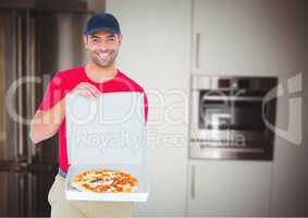 Happy deliveryman showing the pizza in the kitchen