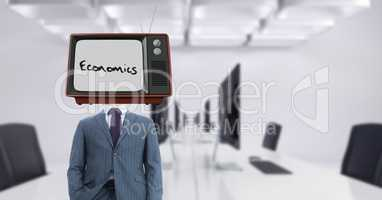 Businessman wearing TV on head with economics text on screen