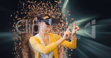 Woman wearing VR glasses with 3d scattered human figure in background