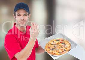 Deliveryman with pizza. Blurred background