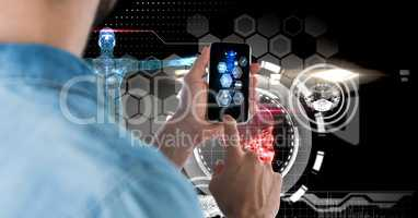 Digital composite image of man using smart phone with tech graphics in background