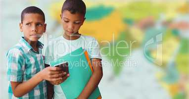Boys with phone against blurry map