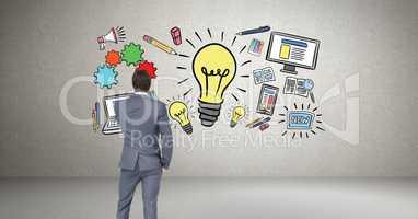 Businessman looking at idea graphics