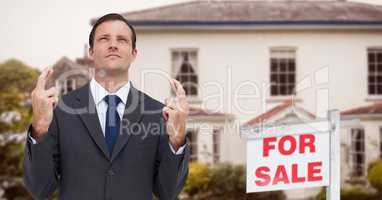 Business man with his fingers crossed, property sale