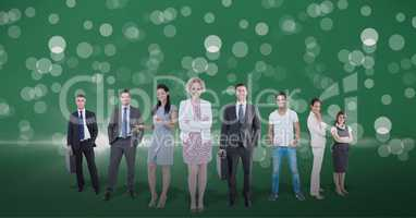 Business people standing against lens flare in green background