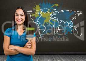 Woman painting a Colorful Map with paint splattered wall background