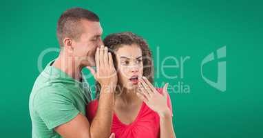 Whispering couple against green background