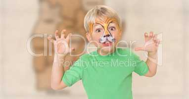Boy with facepaint growling against blurry brown map