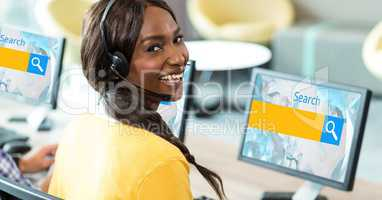 Female customer service representative wearing headphones while searching on net