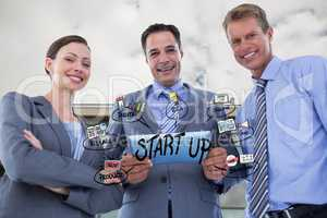 Happy business people with tablet PC representing start up concept