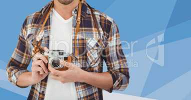 Man mid section with camera against blue vector mesh