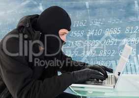 Criminal in hood on laptop in front of numbers interface