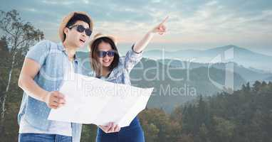 Travelers holding map on mountain