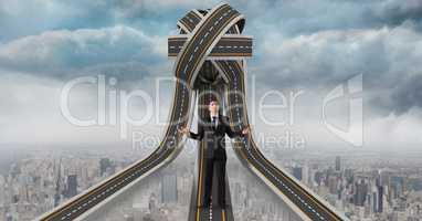 Digital composite image of confused businessman standing on jumbled highway