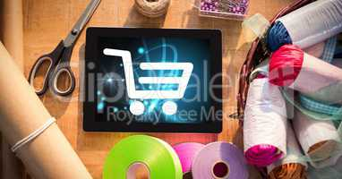 Shopping cart icon on digital tablet by craft products