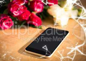 Phone on table with roses and white network overlay