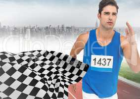 Male runner sprinting on track against misty skyline and checkered flag