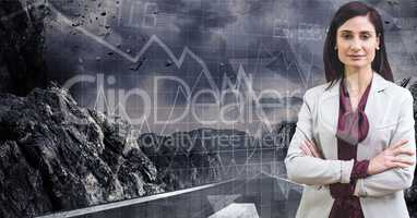 Digital composite image of businesswoman with mountain and graph on grid in background