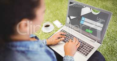 Woman signing up on web page using laptop