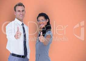 Business people showing thumbs up gesture