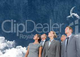 Business people looking up at cloudy sky with moon