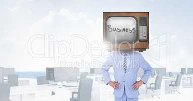 TV on businessman's head with business written on screen