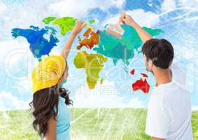 Couple painting Colorful Map with bright sky background