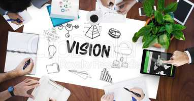 Vision text by icons and business people on table