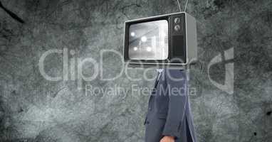 Digital composite image of TV on businessman's head