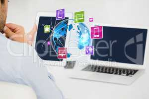Digital composite image of businessman with technologies looking at IOT graphics