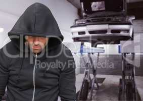 Criminal with hood in car theft mechanics fraud
