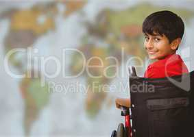 Boy in wheelchair against blurry map