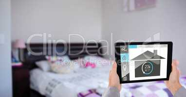 hands using application of smart home on digital tablet