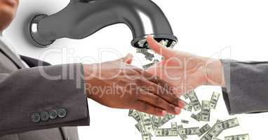 Close-up of business people shaking hands with money flowing from tap