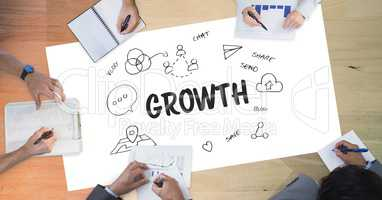 Growth text by icons and business people on table