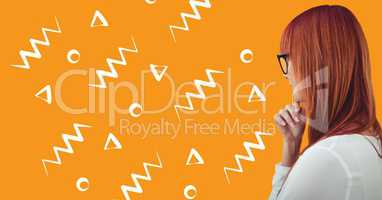 Woman in glasses profile against orange background with white patterns
