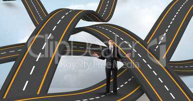 Digitally generated image of businessman standing on wavy road in sky