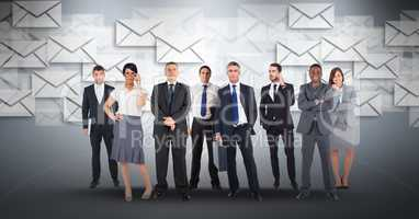 Digital composite image of business people with envelop icons flying in background